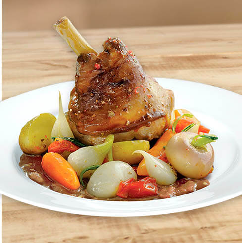 Lamb shank with baby vegetables